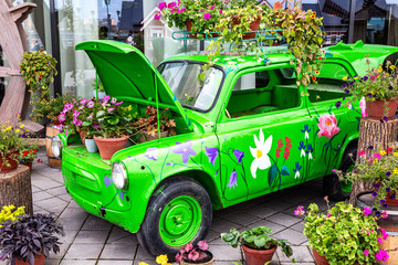 Flowers composition with green retro car