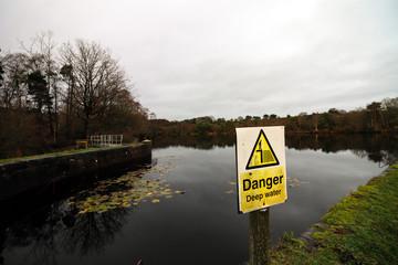 Danger deep water sign at a river