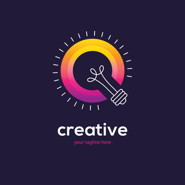 Bright colorful light bulb logo on dark background.