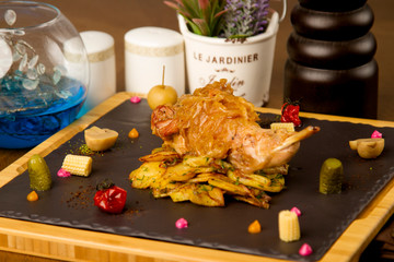 rabbit leg with fried potatoes and onions