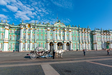 Horse carriages on Palace square and Hermitage museum, St. Petersburg, Russia