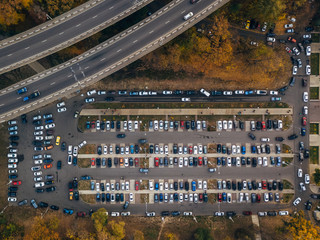 Top view photo of parking lot near bridge of road junction and city park taken by drone