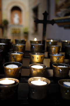 Candles and Cross on an altar at California Mission San Diego de Alcala