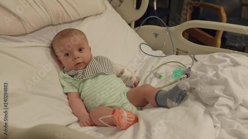 5aca8553a Cute Baby Boy Sitting in Hospital Bed
