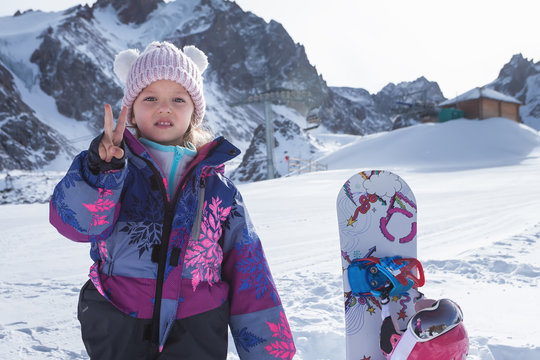 Your happy kid has ski or snowboard lesson at alpine school.
