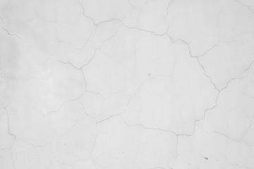 White concrete painted wall with cracks, texture