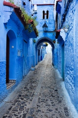 blue tunnel on the street in blue city Chefchaouen in Morocco