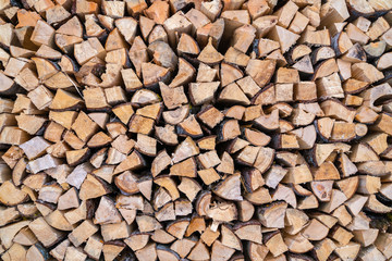 A stack of seasoned firewood logs seen from the front.
