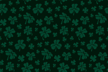 Pattern with green shapes of clover leaves