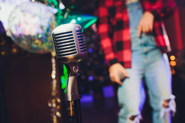 Microphone. Christmas music concept karaoke. Disco. New year celebration.