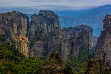 religion, travel, freedom and sightseeing concept of alone mountain monastery on high steep rock top in highland exotic beautiful natural environment, amazing world heritage site, wallpaper concept