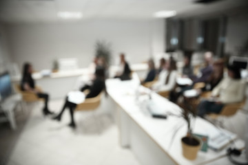 blurred image of a large modern office