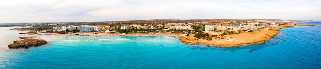 Nissi beach in Ayia Napa, clean aerial photo of famous tourist beach in Cyprus. The best resort area of Cyprus, Nissi beach, the hotels, gulfs, parks.