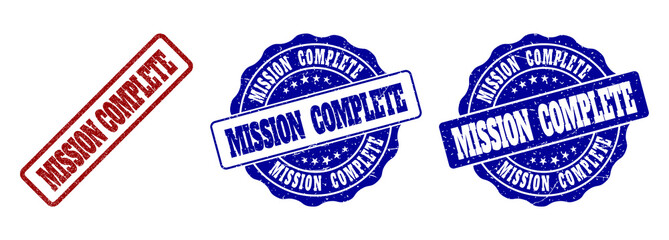 MISSION COMPLETE grunge stamp seals in red and blue colors. Vector MISSION COMPLETE overlays with distress effect. Graphic elements are rounded rectangles, rosettes, circles and text captions.