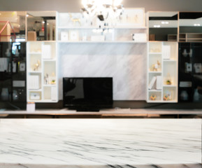 Blurred abstract of modern living room with marble shelf and TV.
