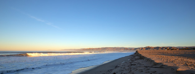 Early morning view of Surfers Knoll beach with tidal erosion at Ventura California United States