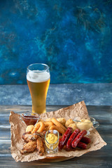 Grilled sausages with glass of beer pic