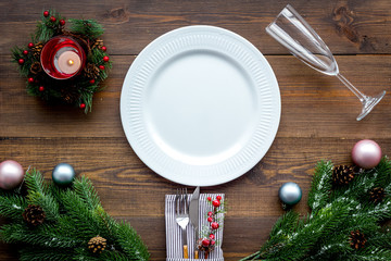 Christmas table setting with gift box and fir tree wooden background top view mockup