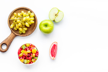 Healthy diet concept. Fruit salad near fresh fruits on white background top view space for text
