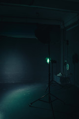 Several reflectors on the black background in photo studio. Preparing for professional shooting