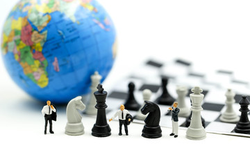 Miniature people : business team strategy training with chess,target, decision and competition concept.