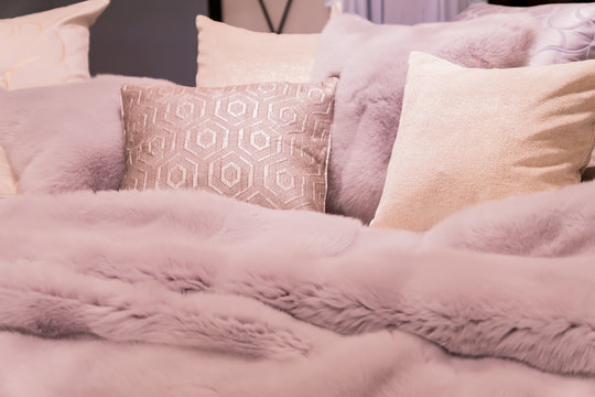 Pastep purple bedding - soft pillows and fur coverlet. coziness, comfort, interior and holidays concept