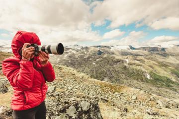 Tourist taking photo fin norwegian mountains