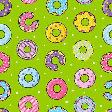 Seamless pattern with color donuts on green