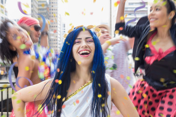 Carnaval party. Group of Brazil people in the city Carnival. Brazilian woman having fun in parade festival.