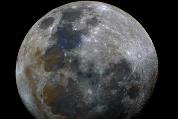 Shining Mineral Moon taken with telescope in waxing gibbous phase in the dark space background, with also its natural colors.