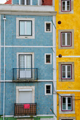 Close up of colorful old houses and windows. Lisbon, Portugal. Color blocks architecture vertical background