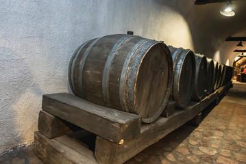 Wooden wine barrels in the cellar