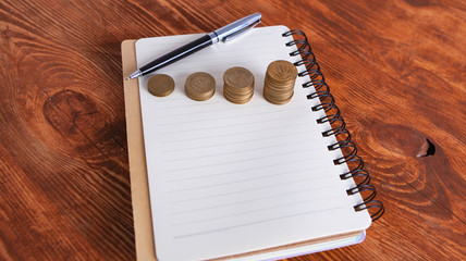 coins notebook pen