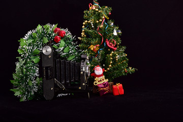 christmas tree with gifts and decorations and photo camera