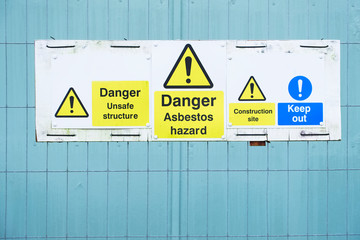 Asbestos hazard danger sign at construction site keep out