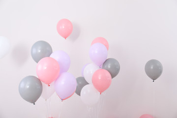 Bright balloons near color wall. Festive decoration