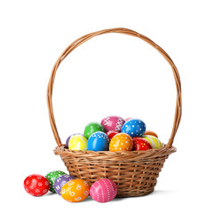 Decorated Easter eggs in wicker basket on white background