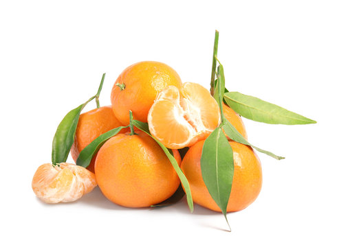 Tasty ripe tangerines with leaves on white background