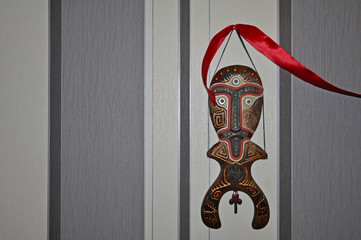 Wooden ethnic figure of a man on the wall