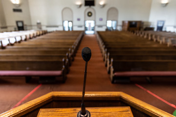 empty church sanctuary view from the pulpit and microphone Fotomurales