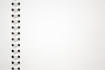 blank white album sheet texture with spiral binding. background