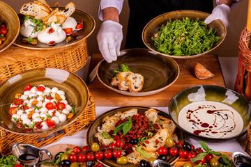 Decoration of salad arugula with pine nuts