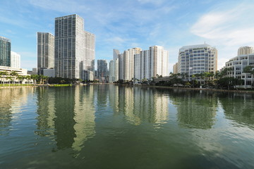 Miami, Florida 09-08-2018 Buildings of the City of Miami and Brickell Key and their reflections on the tranquil water of Biscayne Bay.