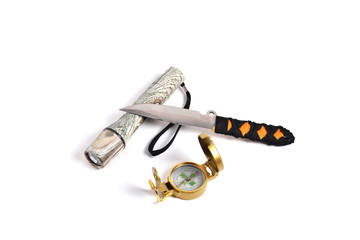 throwing knife camouflage flashlight and compass on a white background close-up