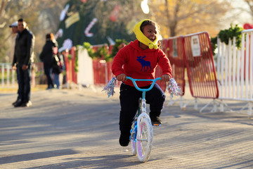 A child rides a bicycle received during the annual gift-giving event organised by the Fire Department, in which they hand out items donated throughout the year to children in need, in Ciudad Juarez