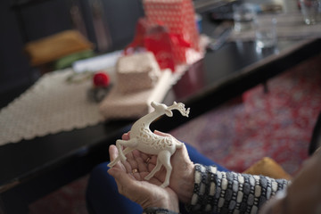 Grandmother making christmas decoration.