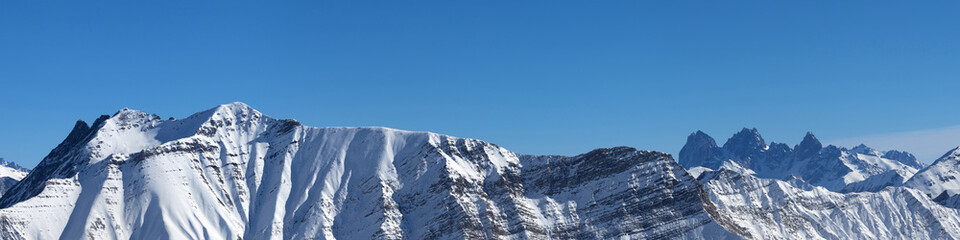 Fototapete - Panorama of snowy mountains and blue clear sky