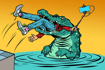 crocodile attacked a man. Dangerous selfie Wall mural