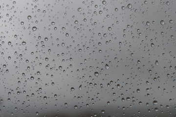 moving raindrops on the glass, interesting raindrops, raindrops falling on glass,