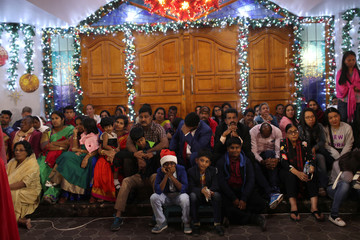 Members of the Christian expatriate community attend a mass on Christmas eve at Santa Maria Church in Dubai